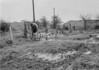 SD620091A, Man marking Ordnance Survey minor control revision point with an arrow in 1950s