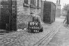 SD650069A, Man marking Ordnance Survey minor control revision point with an arrow in 1940s