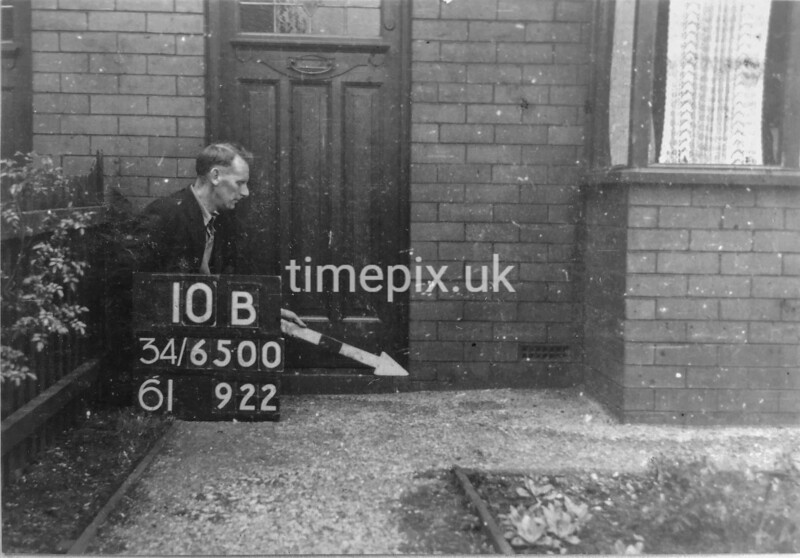 SD650010B, Man marking Ordnance Survey minor control revision point with an arrow in 1940s