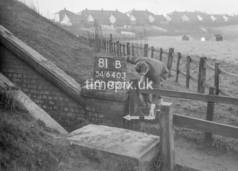 SD640381B, Man marking Ordnance Survey minor control revision point with an arrow in 1940s