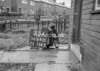 SD640123A, Man marking Ordnance Survey minor control revision point with an arrow in 1940s