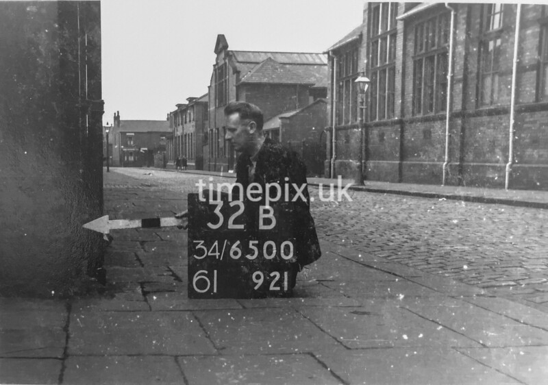 SD650032B, Man marking Ordnance Survey minor control revision point with an arrow in 1940s