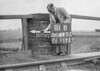 SD640281B, Man marking Ordnance Survey minor control revision point with an arrow in 1940s