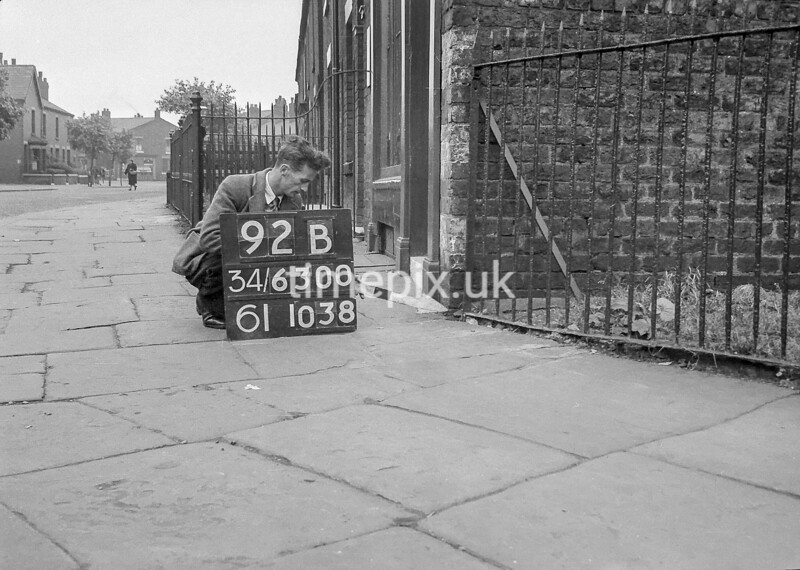SD630092B, Man marking Ordnance Survey minor control revision point with an arrow in 1940s
