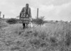 SD640222A, Man marking Ordnance Survey minor control revision point with an arrow in 1940s
