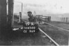 SD650019A, Man marking Ordnance Survey minor control revision point with an arrow in 1940s