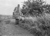 SD640232A, Man marking Ordnance Survey minor control revision point with an arrow in 1940s