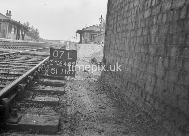 SD640207L, Man marking Ordnance Survey minor control revision point with an arrow in 1940s