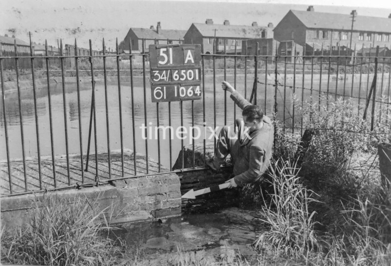 SD650151A, Man marking Ordnance Survey minor control revision point with an arrow in 1940s