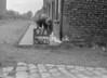 SD640197A, Man marking Ordnance Survey minor control revision point with an arrow in 1940s