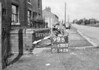 SD630399B, Man marking Ordnance Survey minor control revision point with an arrow in 1950s