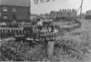 SD650210B, Man marking Ordnance Survey minor control revision point with an arrow in 1950s