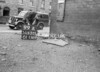 SD630199A, Man marking Ordnance Survey minor control revision point with an arrow in 1940s