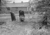 SD630126A, Man marking Ordnance Survey minor control revision point with an arrow in 1950s