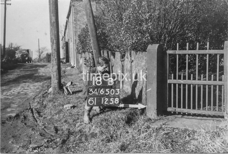 SD650318B, Man marking Ordnance Survey minor control revision point with an arrow in 1940s