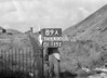 SD640089A, Man marking Ordnance Survey minor control revision point with an arrow in 1940s