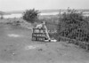 SD640016A, Man marking Ordnance Survey minor control revision point with an arrow in 1940s
