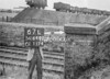 SD640267L, Man marking Ordnance Survey minor control revision point with an arrow in 1940s