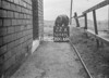 SD640122A, Man marking Ordnance Survey minor control revision point with an arrow in 1940s