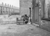SD640118A, Man marking Ordnance Survey minor control revision point with an arrow in 1940s