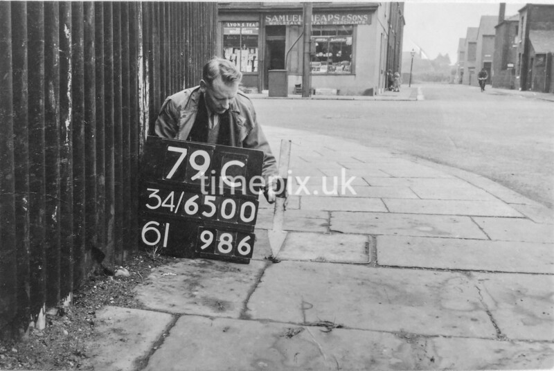 SD650079C, Man marking Ordnance Survey minor control revision point with an arrow in 1940s