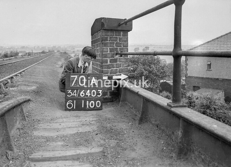SD640370A, Man marking Ordnance Survey minor control revision point with an arrow in 1940s