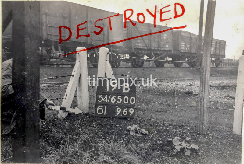 SD650019B, Man marking Ordnance Survey minor control revision point with an arrow in 1940s