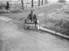 SD640308A, Man marking Ordnance Survey minor control revision point with an arrow in 1940s