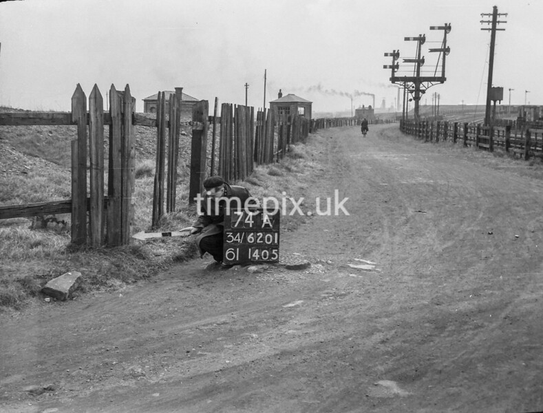 SD620174A, Man marking Ordnance Survey minor control revision point with an arrow in 1950s