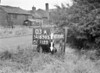 SD630303A, Man marking Ordnance Survey minor control revision point with an arrow in 1940s