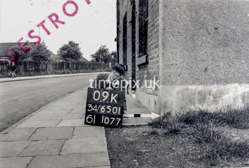 SD650109K, Man marking Ordnance Survey minor control revision point with an arrow in 1940s