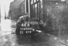 SD650066B, Man marking Ordnance Survey minor control revision point with an arrow in 1940s
