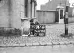 SD630371A, Man marking Ordnance Survey minor control revision point with an arrow in 1940s