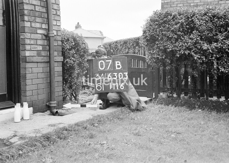 SD630307B, Man marking Ordnance Survey minor control revision point with an arrow in 1940s