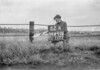 SD640262A, Man marking Ordnance Survey minor control revision point with an arrow in 1940s