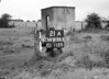 SD630321A, Man marking Ordnance Survey minor control revision point with an arrow in 1940s
