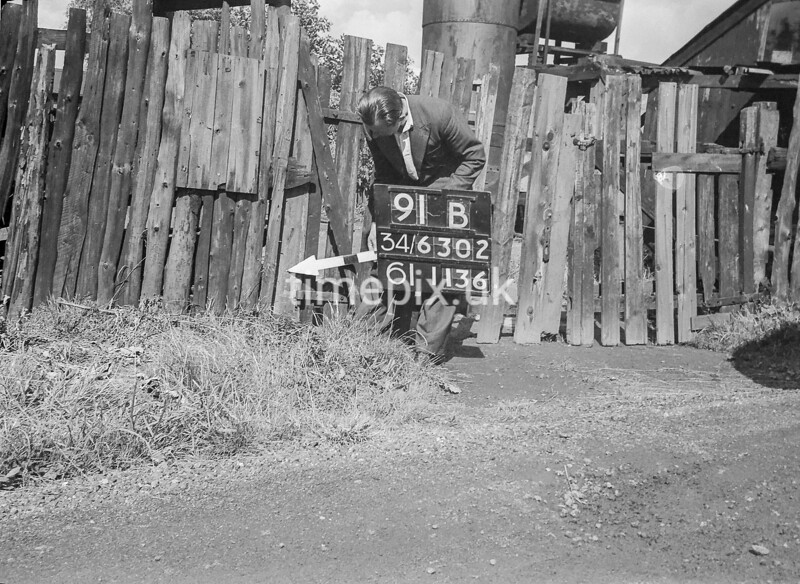 SD630291B, Man marking Ordnance Survey minor control revision point with an arrow in 1940s