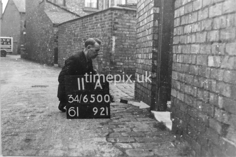 SD650011A, Man marking Ordnance Survey minor control revision point with an arrow in 1940s