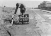 SD650147A, Man marking Ordnance Survey minor control revision point with an arrow in 1940s