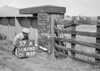 SD620257A, Man marking Ordnance Survey minor control revision point with an arrow in 1950s
