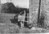 SD650222A, Man marking Ordnance Survey minor control revision point with an arrow in 1940s