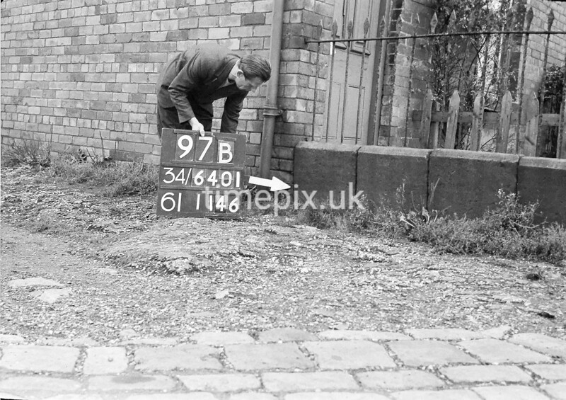 SD640197B, Man marking Ordnance Survey minor control revision point with an arrow in 1940s