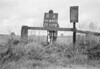 SD640311A, Man marking Ordnance Survey minor control revision point with an arrow in 1940s