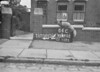 SD640264C, Man marking Ordnance Survey minor control revision point with an arrow in 1940s