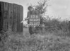 SD640313B, Man marking Ordnance Survey minor control revision point with an arrow in 1940s