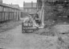 SD640094L, Man marking Ordnance Survey minor control revision point with an arrow in 1940s