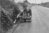 SD650384B, Man marking Ordnance Survey minor control revision point with an arrow in 1940s