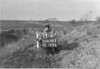 SD650313A, Man marking Ordnance Survey minor control revision point with an arrow in 1940s