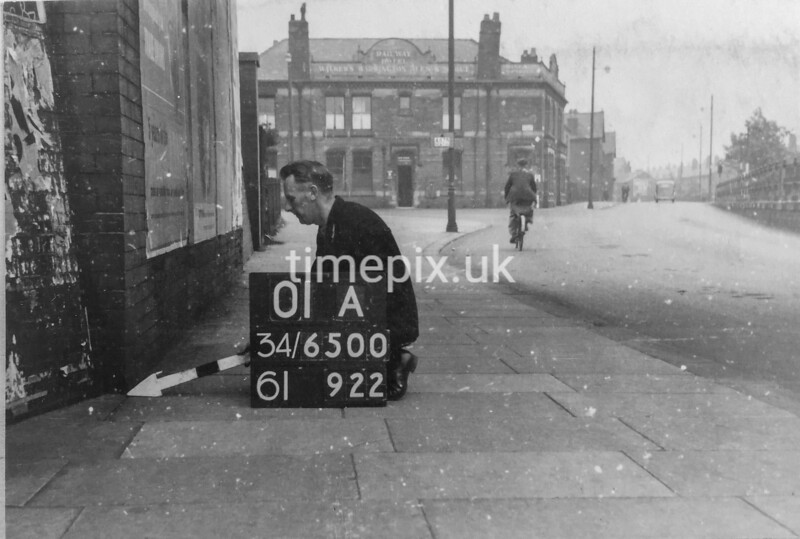 SD650001A, Man marking Ordnance Survey minor control revision point with an arrow in 1940s