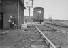 SD620063A, Man marking Ordnance Survey minor control revision point with an arrow in 1950s